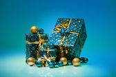 Gift boxes and christmas balls,Isolated on blue background — Stock Photo