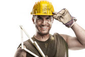 Portrait of dirty worker with helmet measuring with classic wood — Stock Photo