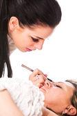 Application of false eyelashes — Stock Photo