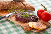 Grilled beef steak, baked potatoes, vegetable — Stock Photo
