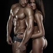 Sexy couple, beautiful woman holding a muscular man isolated on — Stock Photo #50696513
