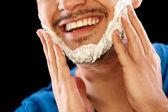 Man with shaving foam — Stock Photo
