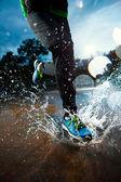 Single runner running in rain — Stock Photo