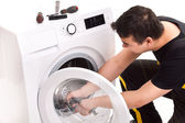 Washing machine repairman — Stock Photo