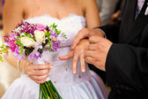 Wedding bouquet with bride and groom — Stock Photo