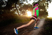 Stretching woman before running — Stock Photo