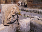 Street fountain still usable in the Ruins in the once buried city of Pompeii Italy — Stock Photo