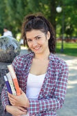 Girl student holding a book in her hands. — Stock Photo