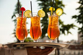 Glasses of ice tea with lemon — Stock Photo