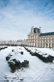 Louvre museum in Paris by winter — Stock Photo