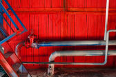 Old industrial factory background. Red wooden wall with pipes. — 图库照片