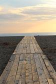 Traces sur le sable, plage et mer — Photo