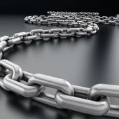 Chain on black reflective background — Stock Photo
