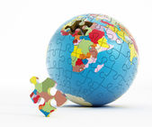 Puzzle parts forming Earth — Stock Photo