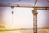 Construction site with cranes, retro tone image — Zdjęcie stockowe