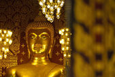 Closeup face of buddha statue in temple buddhism — Стоковое фото