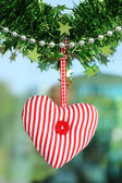 Red heart fabric hanging on glass background — Stock Photo