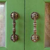 Door handle on green wooden door — Stock Photo