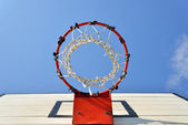 Basketball hoop with blue sky background — Stock Photo