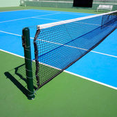 Blue tennis court, tennis net — Stock Photo