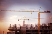 Construction site with cranes on sky background — Stock Photo