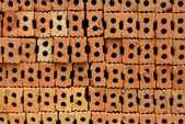 Stack of red bricks, bricks used for building construction — Stock Photo