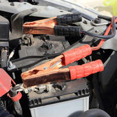Charging battery car with electricity trough jumper cables — Stock Photo