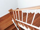 Wooden staircase in a white modern house — Stock Photo