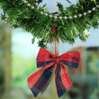 New year festive decoration with green tinsel ribbon — Stock Photo #50578717