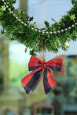 New year festive decoration with green tinsel ribbon — Stockfoto