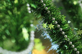 New year festive decoration with green tinsel ribbon — Stock Photo