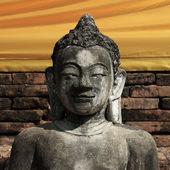Pedra de escultura de estátua de buda com cara dourada — Foto Stock