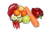 Fresh tomatoes, chilies, pepper and carrot on white — Stock Photo