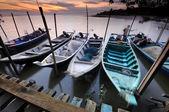 Fisherman docks floating on water at sunset — Stock Photo