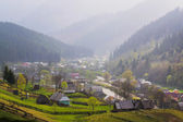 Rural landscape with village houses and mountains — Stock Photo