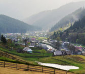 Rural landscape with houses and mountains. — Stock Photo