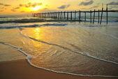 Bridge and sunset beach — Stock Photo