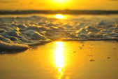 Bubble wave with sunset beach — Stock Photo