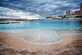 Beach in Monaco with stormy clouds — Stock Photo