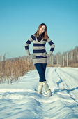Young  brunette girl in the snow field — Stock Photo