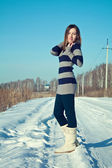 Young brunette girl in the snow field. Winter — Stock Photo
