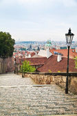 Steps and cityscape view of historical buildings in Prague, Czec — Stock Photo