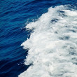 Blue sea water with white foam wave — Stock Photo #50211679
