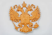 The gold coat of arms of the Russian Federation on a facade of the building of Legislative assembly of the Nizhny Novgorod Region — Stock Photo