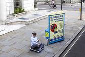 London activist protesting on Portland Place — Stock Photo