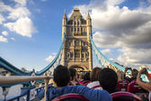 Tourists in a red bus on Tower Bridge — Stock Photo