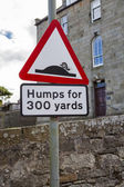 Humps for 300 yards street sign — Stock Photo