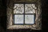 Oozing light - scarred window to the world — Stock Photo