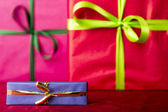 Blue gift with golden bowknot — Stock Photo