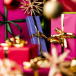Christmas Presents amidst Baubles and Stars — Stock Photo #50603391
